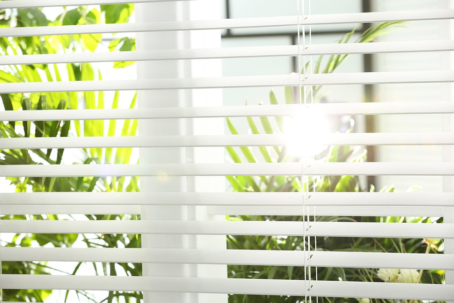 Sun shining through curtains and blinds in Singapore